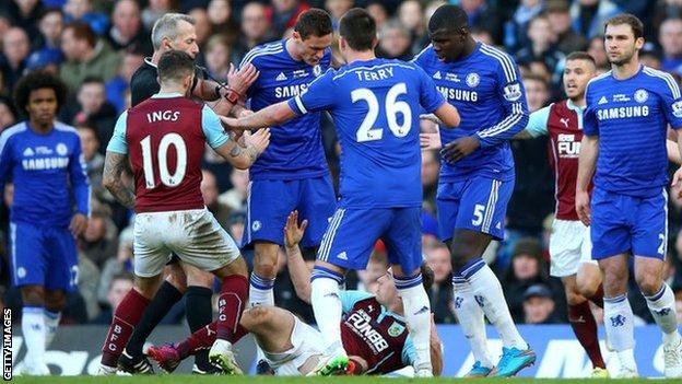 Chelsea midfielder Nemanja Matic clashes with the grounded Burnley forward Ashley Barnes