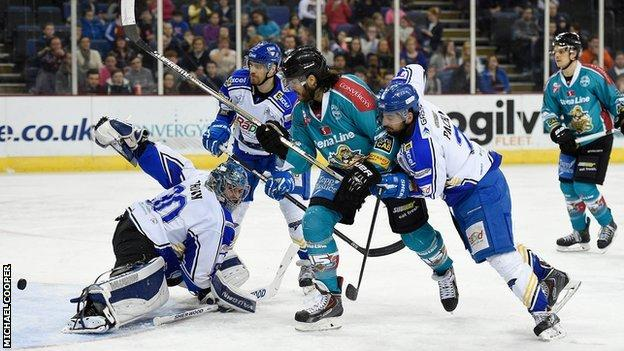 Hull netminder David Brown saves a shot from Belfast's Kevin Westgarth