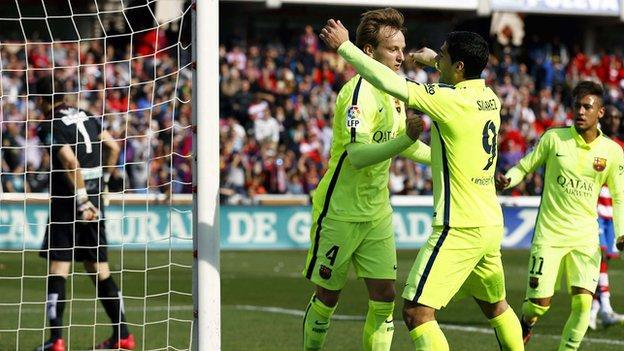 Luis Suarez congratulates Ivan Rakitic
