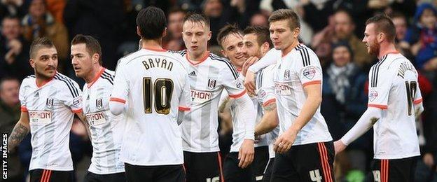 Fulham's players celebrate their opening goal against Derby