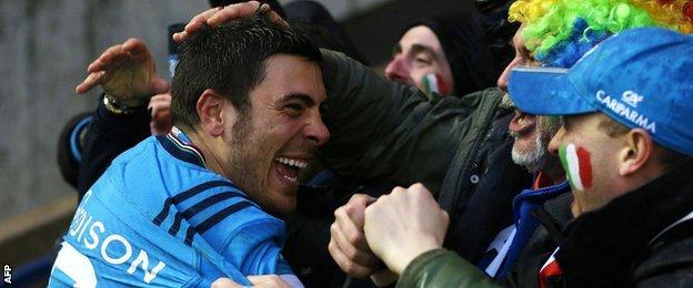 Italy scrum-half Edoardo Gori celebrates with fans