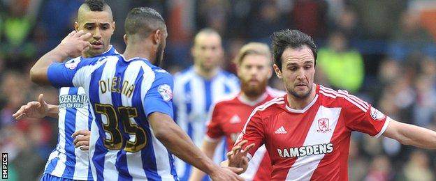 Kike and Sheffield Wednesday players battle for the ball