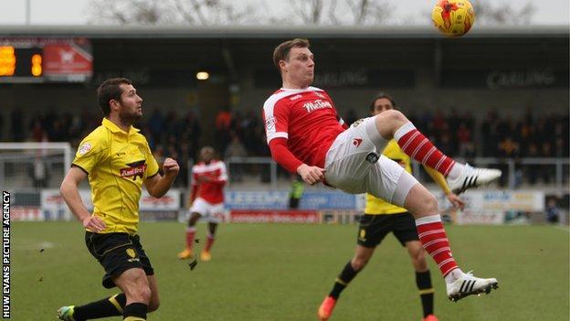 Newport's Adam Chapman in action against Burton Albion