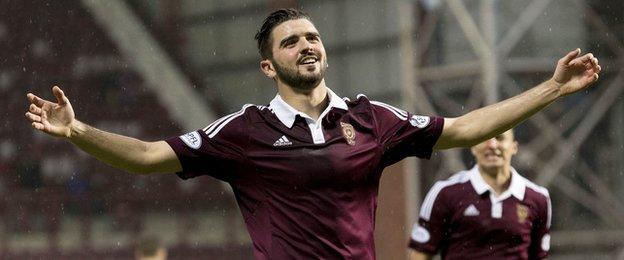 Hearts defender Alim Ozturk celebrates after scoring against Cowdenbeath