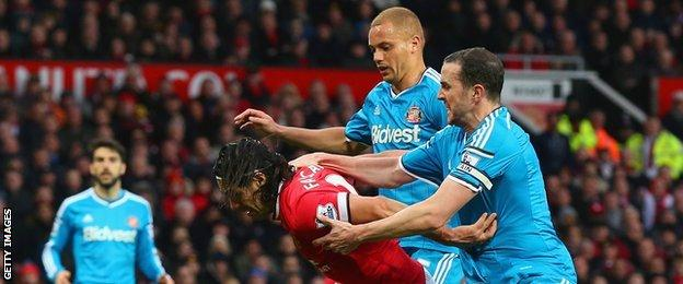 Sunderland defenders Wes Brown (centre) and John O'Shea (left) challenge Manchester United's Radamel Falcao