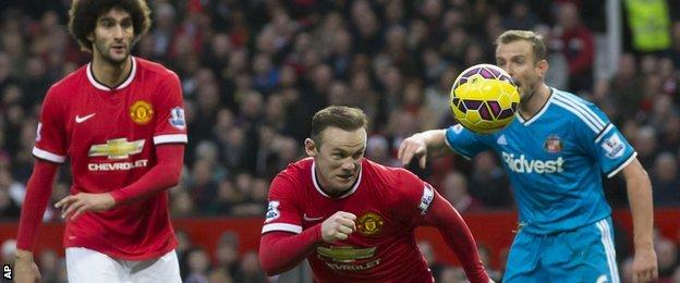 Manchester United striker Wayne Rooney heads in his side's second goal against Sunderland