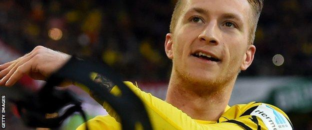 Dortmund's Marco Reus celebrates after his team score gainst Schalke