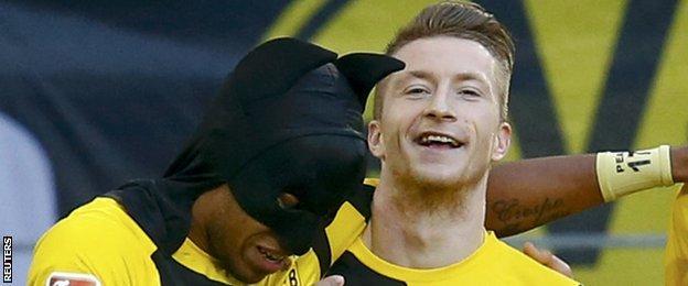 Borussia Dortmund players Pierre-Emerick Aubameyang and Marco Reus celebrate their team's first goal against Schalke