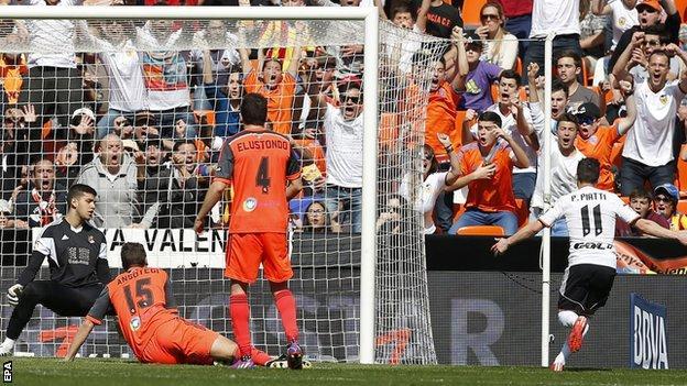 Valencia's Pablo Piatti scores against Real Sociedad