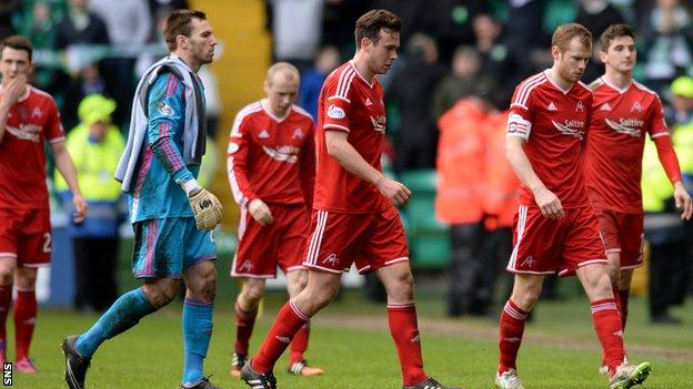 The Aberdeen players were left dejected after crashing to a 4-0 defeat t Celtic Park on Sunday