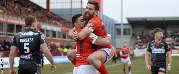 Ken Sio of celebrates his opening try with Tyrone McCarthy