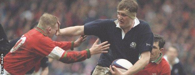 Doddie Weir fends off Wales' Neil Jenkins during the 1995 Five Nations Championship