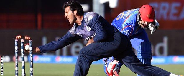 Scotland's Majid Haq tries to run out Afghanistan's Hamid Hassan