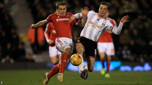 Robert Tesche tussles with Fulham's former England midfielder Scott Parker