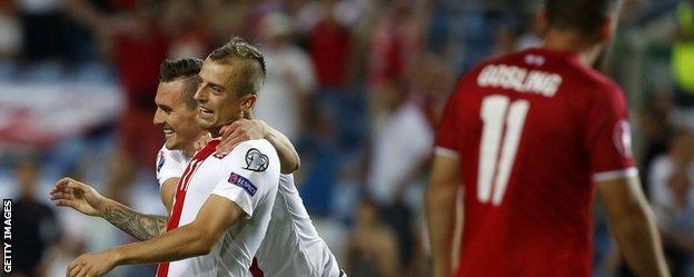Kamil Grosicki and Arkadiusz Milik celebrate for Poland against Gibraltar