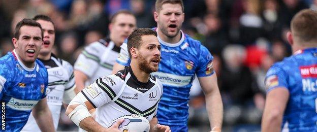 Widnes' Lloyd White runs through the Wakefield defence