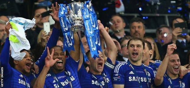 Chelsea players celebrate winning the League Cup