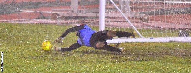 Chris Tardif saves a penalty against Hastings United
