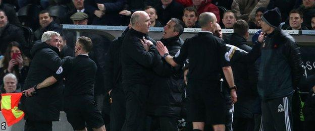 But then Bruce becomes upset and has to be restrained by an official and members of his coaching staff
