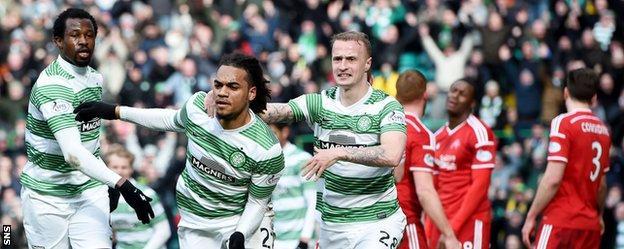 Celtic players celebrate Jason Denayer's goal against Aberdeen