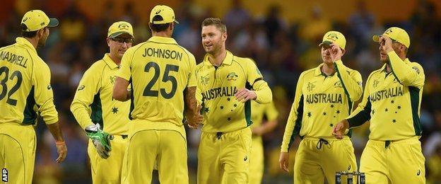 Michael Clarke (centre) celebrates after taking the wicket of Samiullah Shinwari