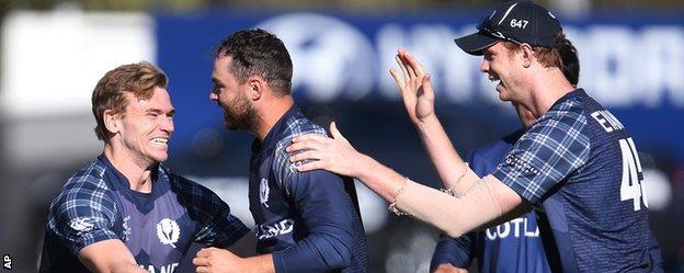 Preston Mommsen (centre) celebrates a catch against Afghanistan