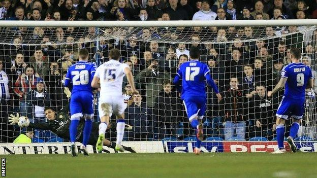 Leeds goalkeeper Marco Silvestri saves a late penalty from Daryl Murphy