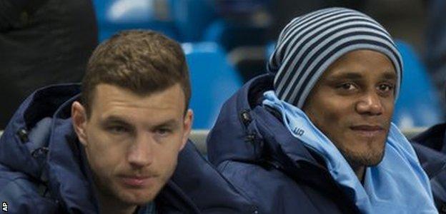 Manchester City captain Vincent Kompany (right)