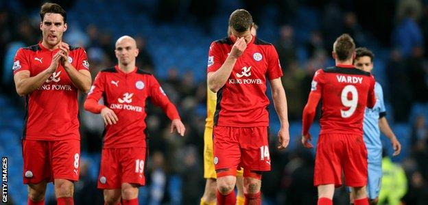 Leicester City players react after their 2-0 defeat at Manchester City