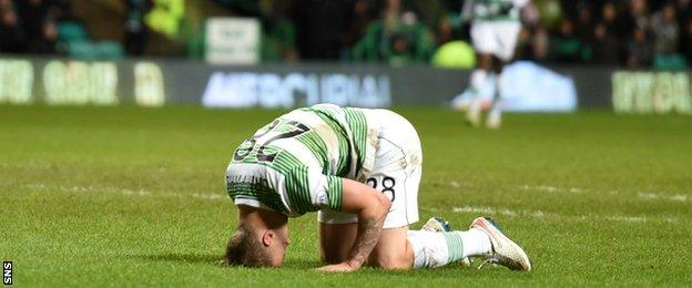 Leigh Griffiths is dejected after passing up an opportunity to level for Celtic.