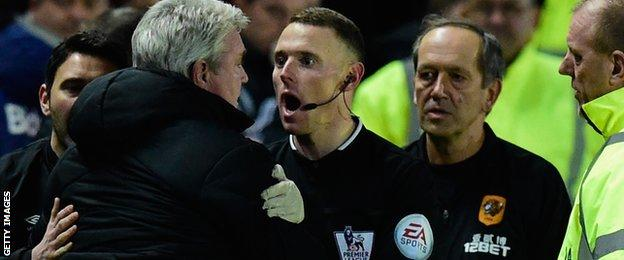 Steve Bruce restrained by assistant referee