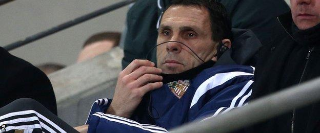 Gus Poyet watches from the stands at Hull