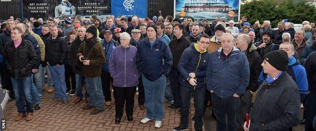 Rangers fans gather outside Ibrox