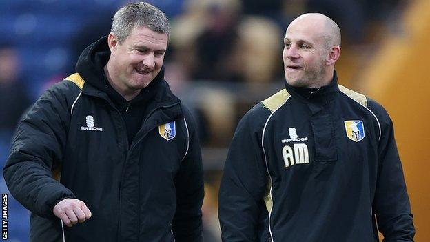 Mansfield manager Adam Murray (right) and assistant boss Micky Moore