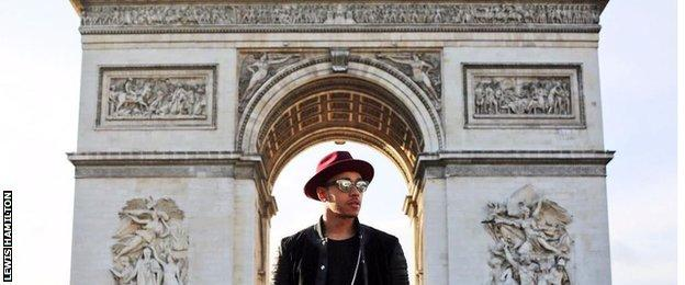 Lewis Hamilton stood in front of the Arc De Triomphe