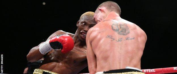 Zolani Tete punches Paul Butler