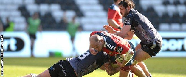 BJ Botha is tackled by the Ospreys
