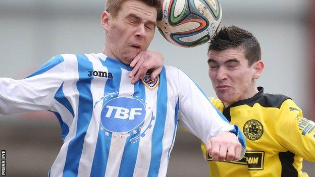 Coleraine striker Ian Parkhill in an aerial duel with Caoimhin Bonner
