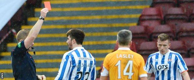 Kilmarnock's Darryl Westlake is sent off just before half-time for a second yellow card offence