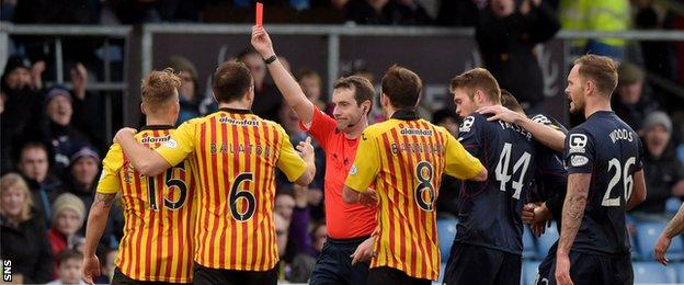 Kallum Higginbotham is sent off by referee Alan Muir