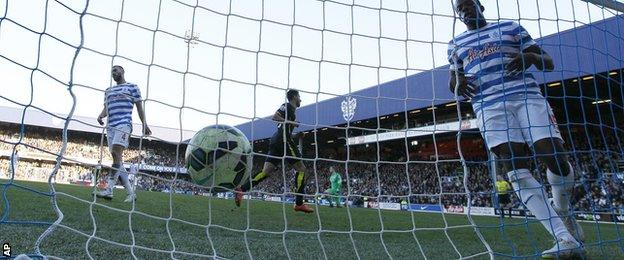 Nedum Onuoha watches the ball hit the back of the net after Tottenham's second goal