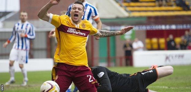 Motherwell's Marvin Johnson goes down in the penalty box and has his penalty claim turned down