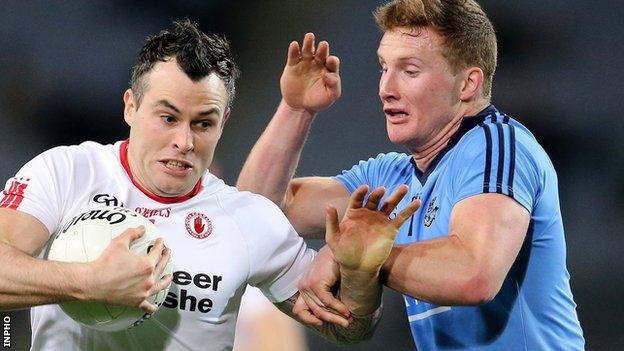 Cathal McCarron of Tyrone is challenged by Dublin's Ciaran Kilkenny