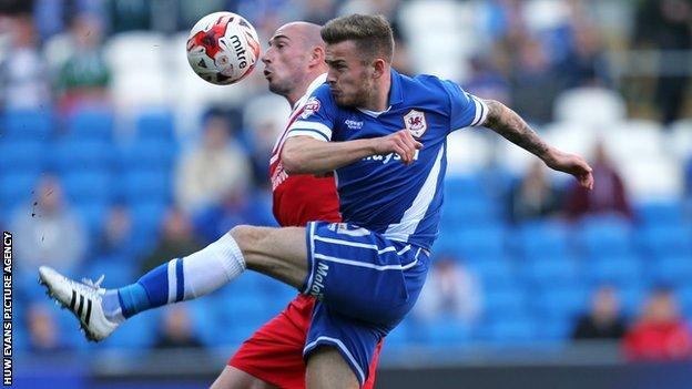 Cardiff City's Joe Ralls and Charlton's Christophe Lepoint compete for the ball