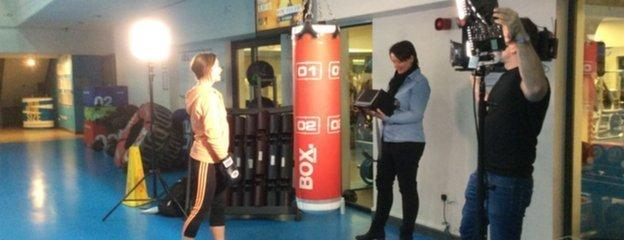Suzi Perry getting ready to kick box on the set of the shoot