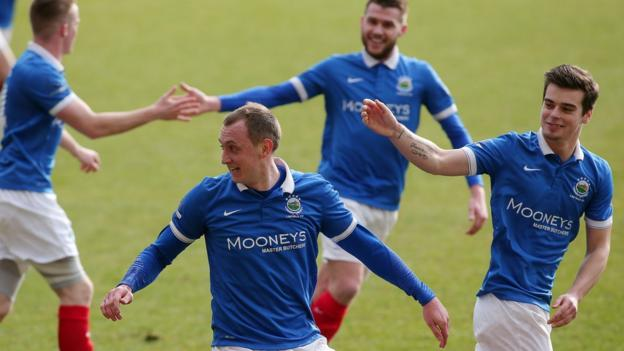 Sammy Morrow celebrates with Linfield team-mates after scoring the second goal in the 3-0 home win over Warrenpoint Town