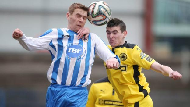 Coleraine's Ian Parkhill goes head to head with Caoimhin Bonner of Cliftonville