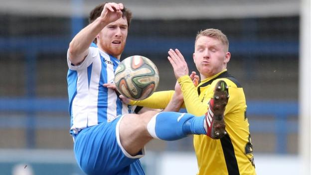 Coleraine defender Howard Beverland and Martin Murray of Cliftonville in action during the 0-0 draw at the Showgrounds