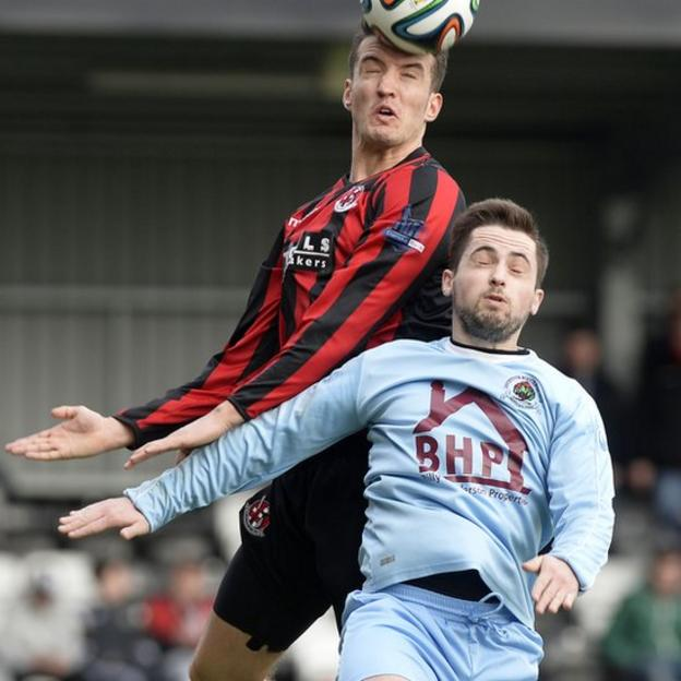 Josh Robinson of Crusaders wins an aerial battle against Institute's Robbie Hume at Seaview