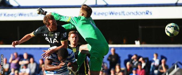 Harry Kane beats QPR goalkeeper Rob Green to the ball to give Tottenham the lead
